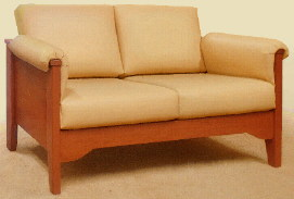 small, sturdy oak loveseat for a yacht